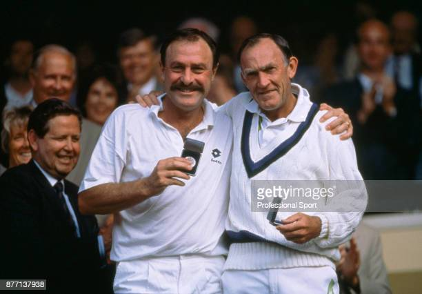 Veteran tennis players John Newcombe and Tony Roche both of Australia with their runnersup medals after losing the Men's Over45 Doubles Final Marty...