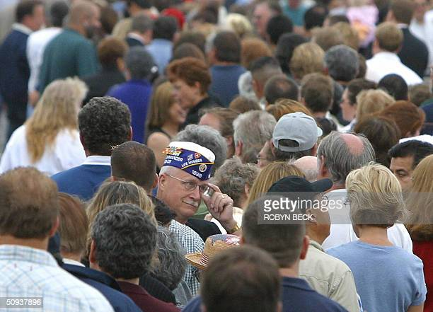 A veteran waits in line with thousands of other mourners at Moorpark College in Moorpark California to board buses that will take them to see the...