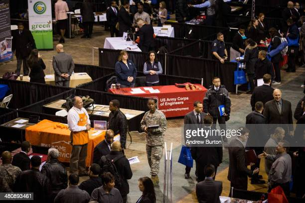 A veteran walks through a 'Hiring our Heroes' Job Fair on March 27 2014 in New York City The jobs fair which was put together by the New York...