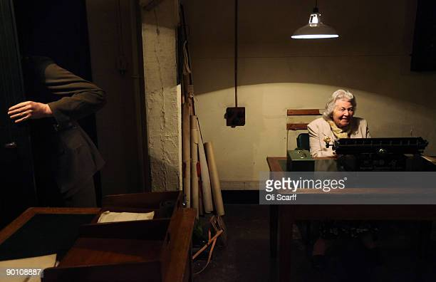 Veteran War Room shorthand typist Myra Collyer sits behind a typewriter in the Cabinet War Rooms bunker where she used to work during the second...