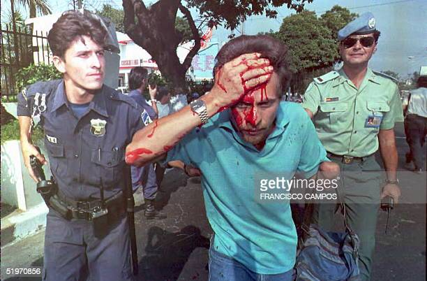 A veteran who lost his left arm during the Salvadoran civil war is arrested by a police officer 29 March after police broke up a veteran's...