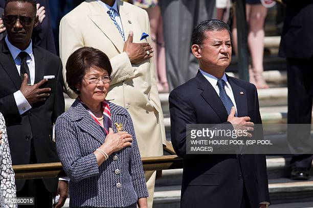 Veterans Affairs Secretary Eric Shinseki and his wife Patricia Shinseki look on during as President Barack Obama attends a wreath laying ceremony at...