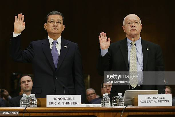S Veterans Affairs Secretary Eric Shinseki and Veterans Affairs Undersecretary for Health Robert Petzel are sworn in before testifying to the Senate...