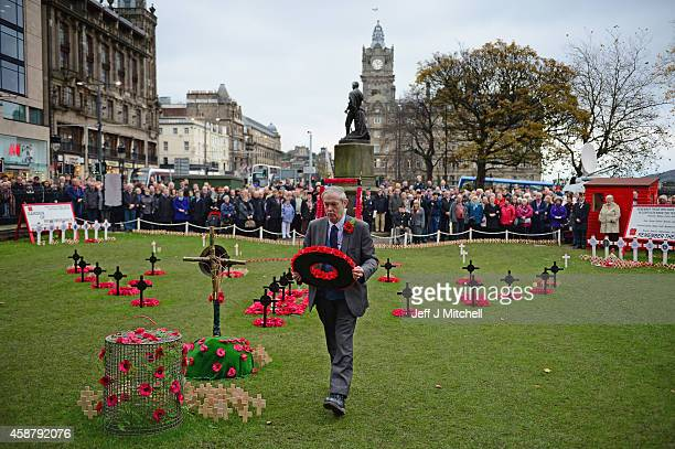 Veterans and members of the public pay tribute to those who died during the two World Wars and subsequent conflicts at the garden of remembrance on...