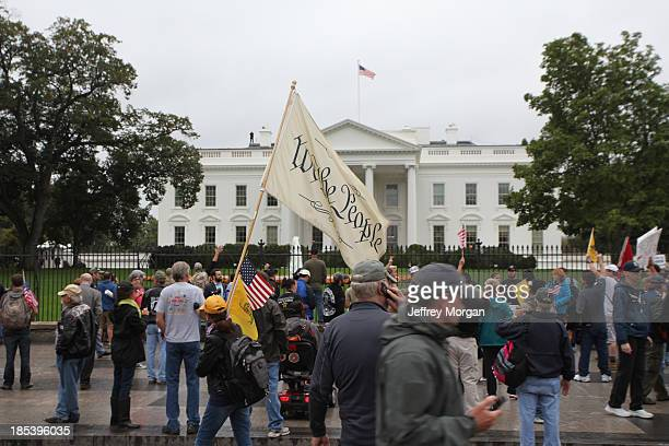 Veterans and Protesters angered by the Government Shutdown gather in front of The White House. 10-13-13 Million Vet March WWII Memorial Washington...
