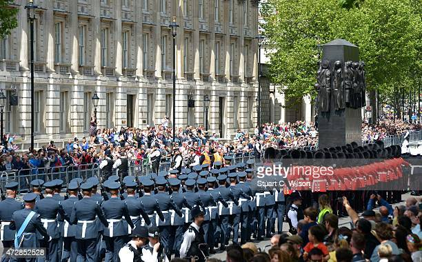 Veterans and serving military march down Whitehall past The Cenotaph during the VE Day Anniversary parade on May 10 2015 in London England