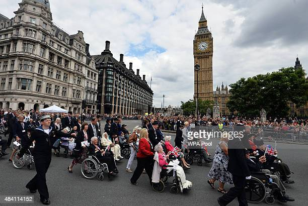 Veterans and their families pass through Parliament Square as they take part in a parade from Horse Guards Parade to Westminster Abbey after a...