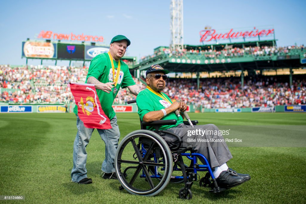 Veterans are introduced onto the field during a ceremony honoring Vietnam Veterans before a game between the Boston Red Sox and the New York Yankees on July 15, 2017 at Fenway Park in Boston, Massachusetts.