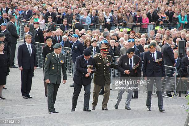 """Veterans are seen in front of the Dutch King Willem-Alexander , Queen Maxima during the annual """"National Commemoration"""" ceremony held for the victims..."""