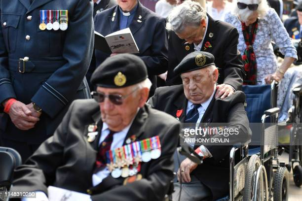 TOPSHOT Veterans attend a service at the National Memorial Arboretum in Alrewas Staffordshire on June 6 during an event to commemorate the 75th...