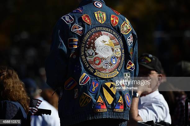 S veterans attend a Veterans Day ceremony at the Vietnam Veterans Memorial November 11 2014 in Washington DC Originally established as Armistice Day...