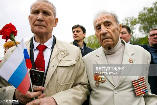 Veterans attend an event to commemorate the 74th anniversary of the victory over Nazi Germany at the Soviet Memorial in Berlin's Treptower Park on...