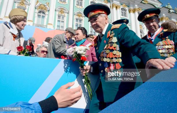 Veterans attend the Victory Day military parade on Dvortsovaya Square in downtown Saint Petersburg on May 9 2019 Russia celebrates the 74th...