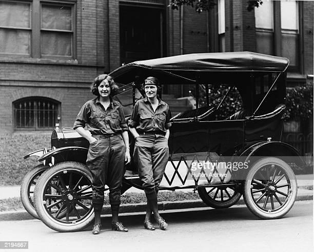 Veterans Bureau employee Viola LaLonde and Census Bureau employee Elizabeth Van Tuyl pose beside a Ford automobile before making their crosscountry...
