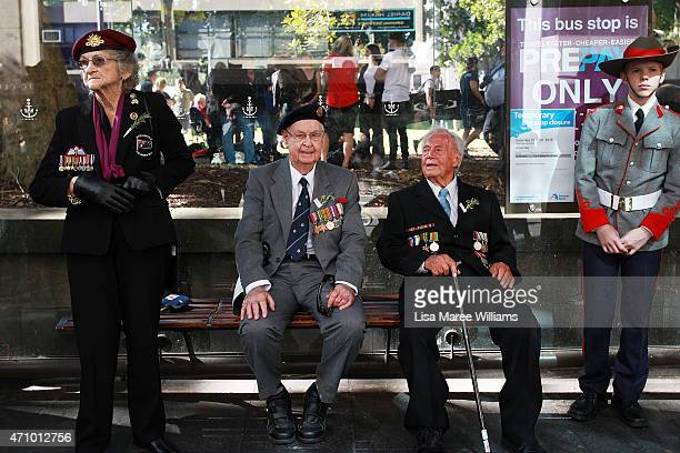 Veterans David Curry and Dennis Moule sit in a bus stop following the Anzac Day Parade on April 25 2015 in Sydney Australia Australians are...