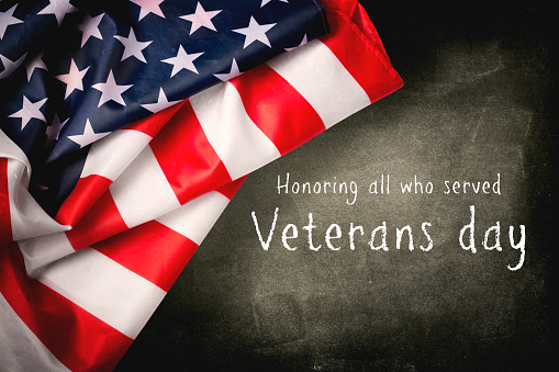 Veterans day background with text and USA flag 1055887818
