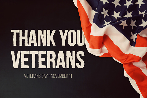 Veterans day background with text and USA flag 868015300