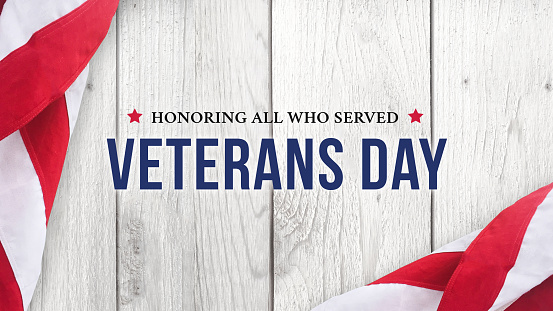 Veteran's Day - Honoring All Who Served Text Over White Wood 1065241474