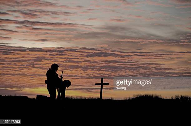 veterans' day soldier - soldier praying stock photos and pictures