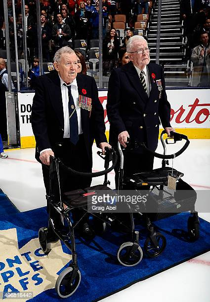Veterans Douglas Cochrane and John Waddell take part in the Remembrance Day pregame salute prior to the game between the Toronto Maple Leafs and the...