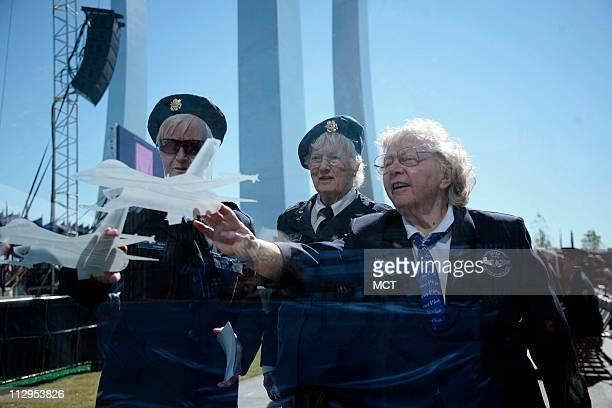 AF Veterans FG Reynolds Elaine Harmon and Barbara Squire look through a glass panel of the missing man formation at the opening ceremony of the Air...