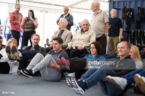 Veterans Fred Glover Ted Pieri and Dick Carpenter watch as a basic lesson takes place ahead of their skydive at the Old Sarum airfield on August 10...