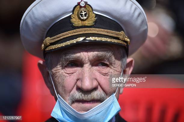 Veterans gather to watch a military parade marking the 75th anniversary of the Soviet Union's victory over Nazi Germany in World War Two, Minsk, May...