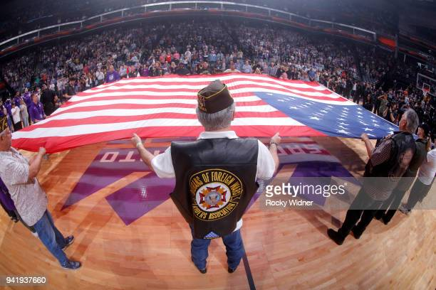 Veterans hold up the American flag during the national anthem of the game between the Indiana Pacers and Sacramento Kings on March 29 2018 at Golden...