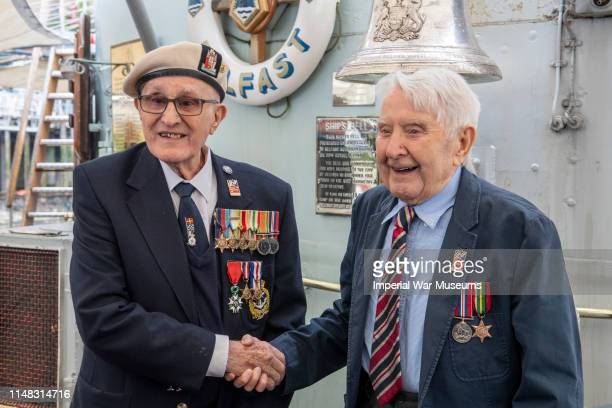 DDAY Veterans John Connelly and Nev Lees on board HMS Belfast on June 6 2019 in London England DDay veterans from Blind Veterans UK were onboard the...