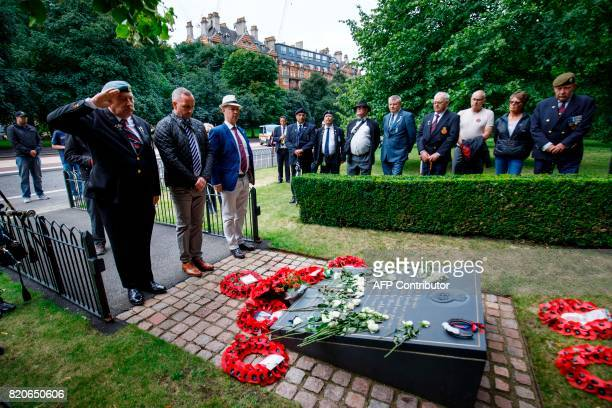 Veterans lay wreaths at the memorial to those who died in a 1982 IRA bomb attack after a march to demand justice in London on July 22 2017 Relatives...