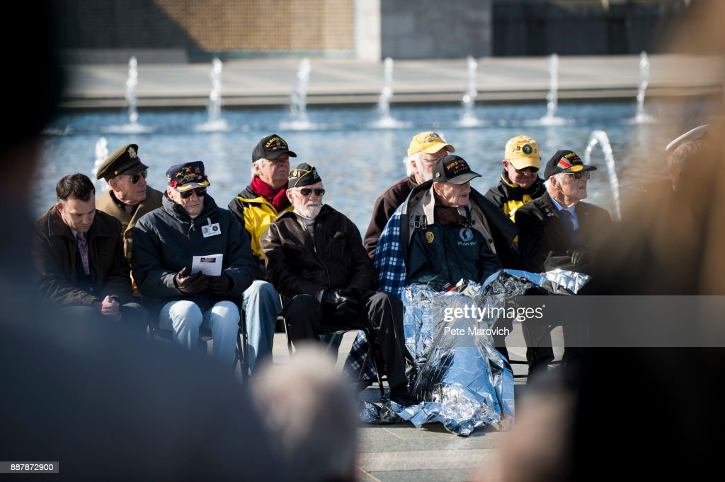 WWII veterans look on as the Friends of the National World War II Memorial and the National Park Service, commemorate Pearl Harbor Remembrance Day on December 7, 2017 in Washington, DC. World War II veterans and Pearl Harbor survivors placed wreaths at the Freedom Wall to commemorate the more than 400,000 Americans who lost their lives during World War II, including the more than 2,400 who lost their lives on December 7, 1941.
