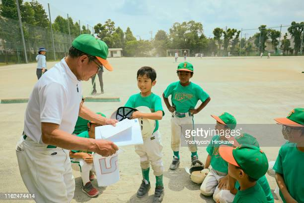 veteran's manager has decided the number for boys baseball players - pe teacher stock photos and pictures