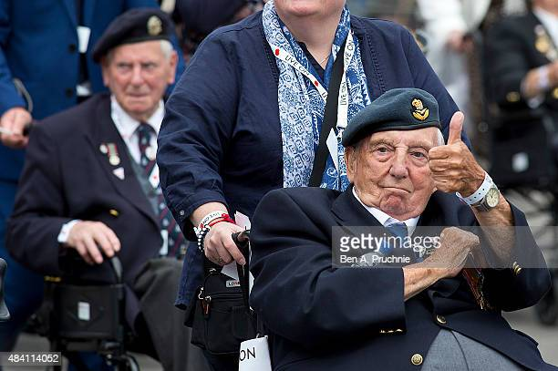Veterans march in a parade during the 70th Anniversary commemorations of VJ Day at Parliament Square on August 15 2015 in London England on August...