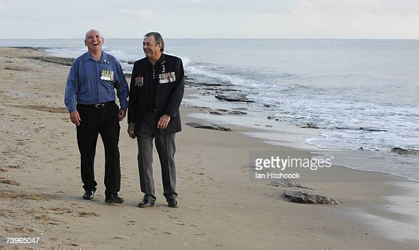 Veterans Mick Coulson and Laurie Roberts share a laugh during an ANZAC day commemorative dawn service at Balgal Beach April 25 2007 Australians and...