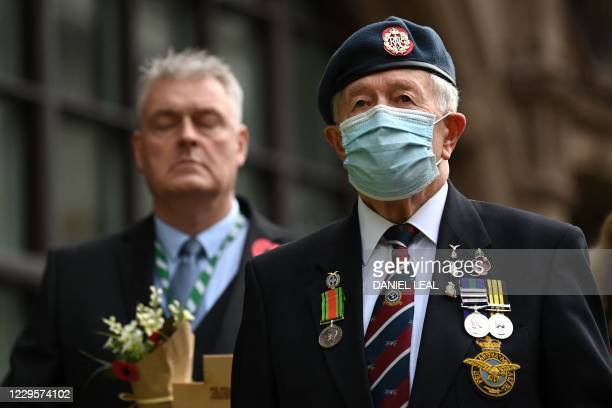 Veteran's observe a 2 minute silence for Armistice day in remembrance of the nations war dead on November 11, 2020 at the Cenotaph in London.