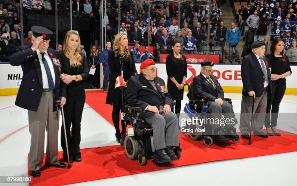 Veterans of the Canadian Armed Forces take part in an on ice ceremony honouring Remembrance Day prior to NHL game action between the Toronto Maple...