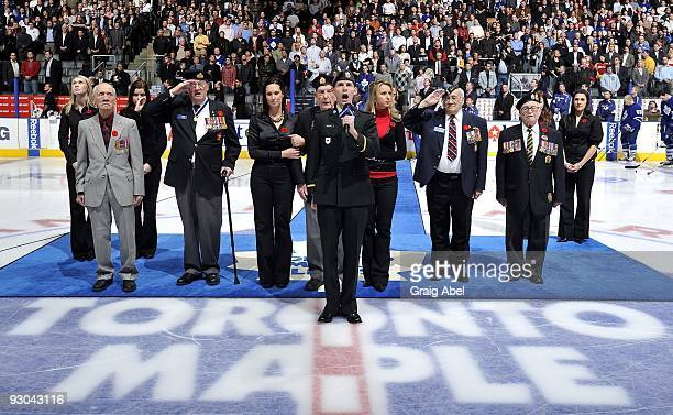 Veterans of the Canadian Military participate in Remembrance Day on ice ceremonies prior to game action between the Toronto Maple Leafs and the...