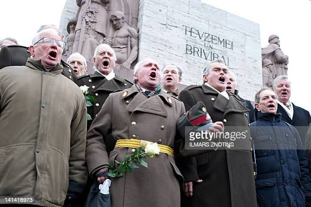 Veterans of the Latvian Legion a force that was part of the Nazi German Waffen SS sing on March 16 2012 at the Monument of Freedom in Riga during...