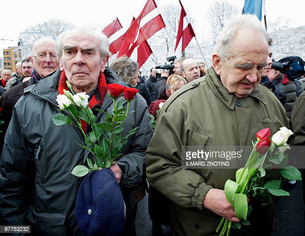 Veterans of the Latvian Legion a force that was part of the Nazi German Waffen SS walk with relatives to the Monument of Freedom as part of an annual...