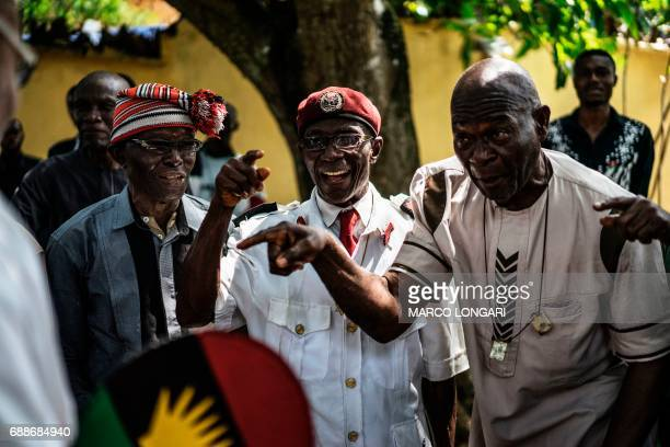 Veterans of the Nigerian civil war gesture while being received by political activist and leader of the Indigenous People of Biafra movement Nnamdi...