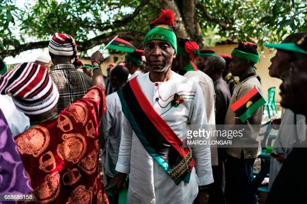Veterans of the Nigerian civil war wearing the red green and black of the Biafra flag are received by political activist and leader of the Indigenous...