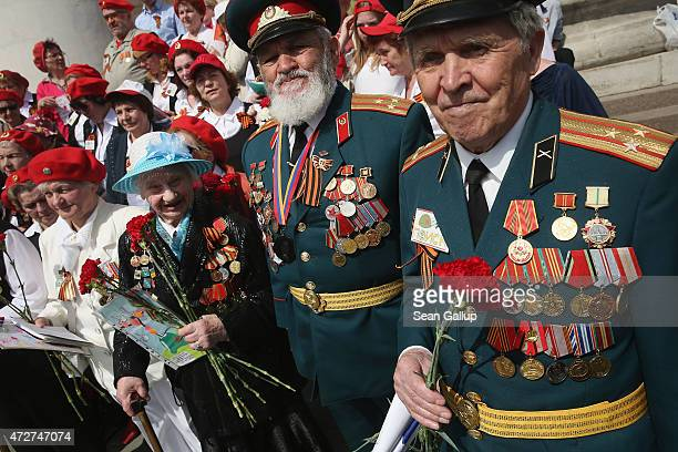 Veterans of the World War II Soviet Red Army join a choir near the Bolshoi Theater to celebrate Victory Day as part of celebrations marking the 70th...