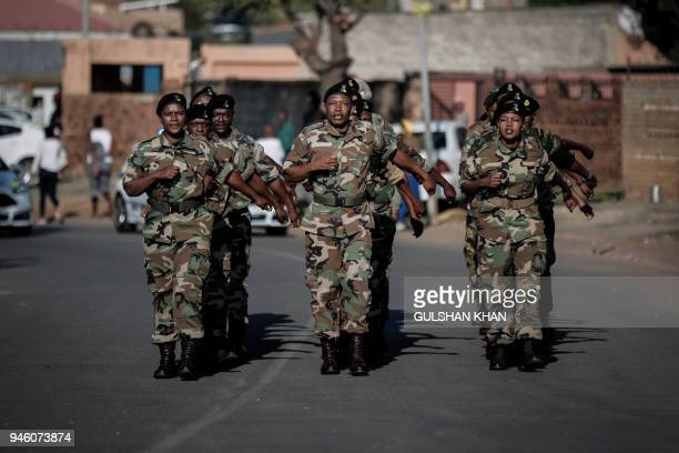 Veterans of Umkhonto we Sizwe the military wing of the African National Congress march as they form a guard of honor ahead of the the motorcade...