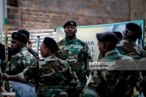 Veterans of Umkhonto we Sizwe the military wing of the African National Congress prepare for the motorcade in the streets of Soweto Johannesburg on...