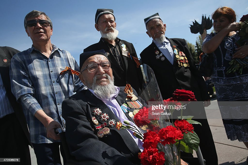 Veterans of World War II, including Tammatov Zybaydula (in a wheelchair), 98, an Uzbek who served in the Soviet Red Army, arrive at the grand memorial to Soviet soldiers killed during World War II at Victory Park ahead of celebrations to mark the 70th anniversary of the victory over Nazi Germany and the end of World War II on May 8, 2015 in Moscow, Russia. The city of Moscow will celebrate the anniversary on May 9 with a Victory Day international military parade and other events that most European leaders are snubbing because they accuse Russia of involvement in the war in eastern Ukraine.