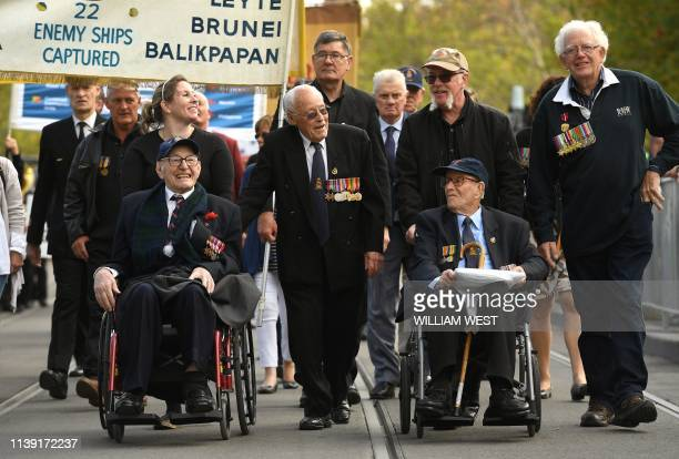 Veterans parade through the streets of Melbourne on April 25 after thousands of people attended the Anzac Day dawn service at the Shrine of...