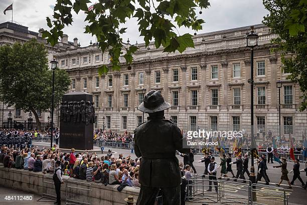 Veterans process down Whitehall past a statue of Field Marshall Slim during the 70th Anniversary commemorations of VJ Day on August 15 2015 in London...