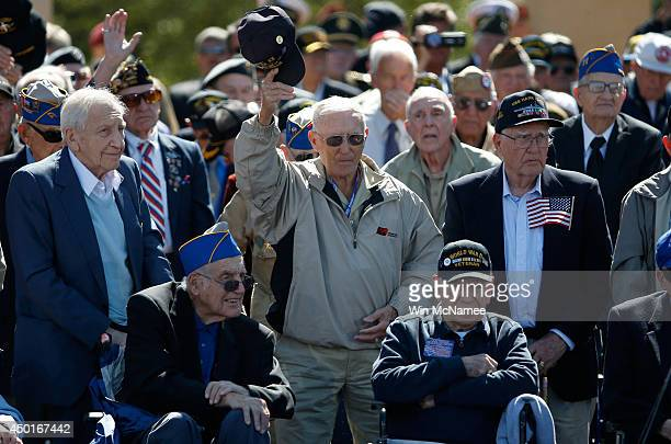 Veterans react to a standing ovation from the audience at a ceremony with US President Barack Obama at the Normandy American Cemetery on the 70th...