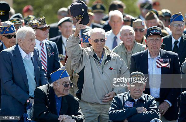 Veterans react to applause at a ceremony with US Preident Barack Obama at the Normandy American Cemetery on the 70th anniversary of DDay June 6 2014...
