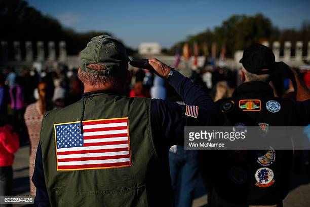 S veterans salute during the playing of the national anthem during a Veterans Day ceremony at the World War Two Memorial November 11 2016 in...